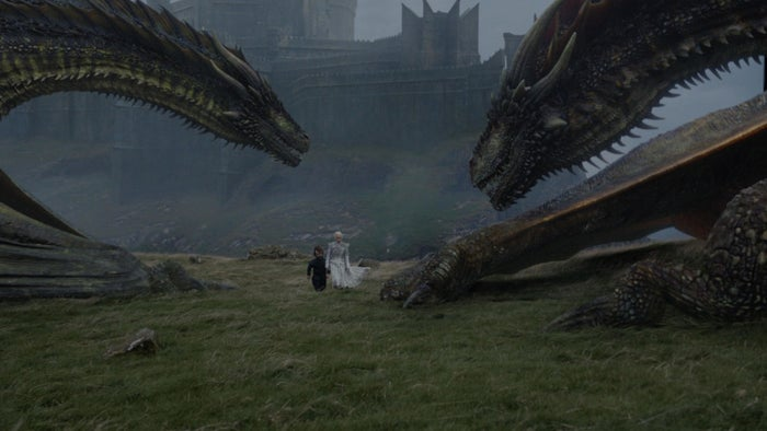 Tyrion (Peter Dinklage) and Daenerys (Emilia Clarke) walk among dragons.