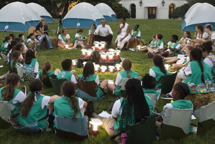 Barack and Michelle Obama talk with Girl Scouts camping on the South Lawn of the White House in 2015.