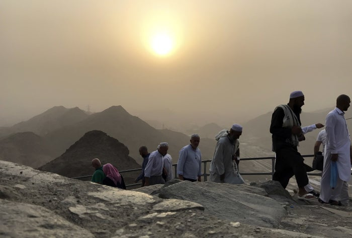 Muslim pilgrims climb the Jabal al-Nour to visit the Cave of Hira, where the Prophet Muhammad is believed to have received the first revelations of the Qur'an, during the annual hajj pilgrimage in Mecca, Saudi Arabia, on Aug. 24.
