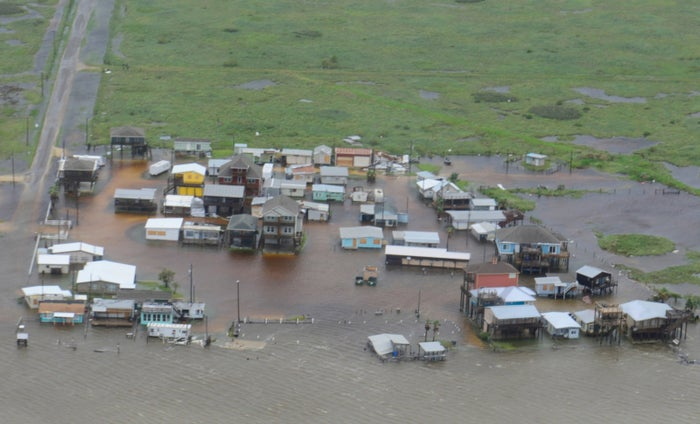 Flooded houses are seen from a US Coast Guard helicopter during a flight from Port Aransas to Port O'Connor, Texas, on Saturday.