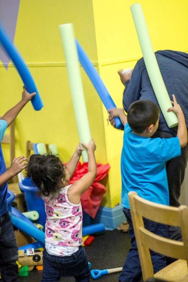 Children, many of them from Central America, play inside a church after being dropped off at the bus station.