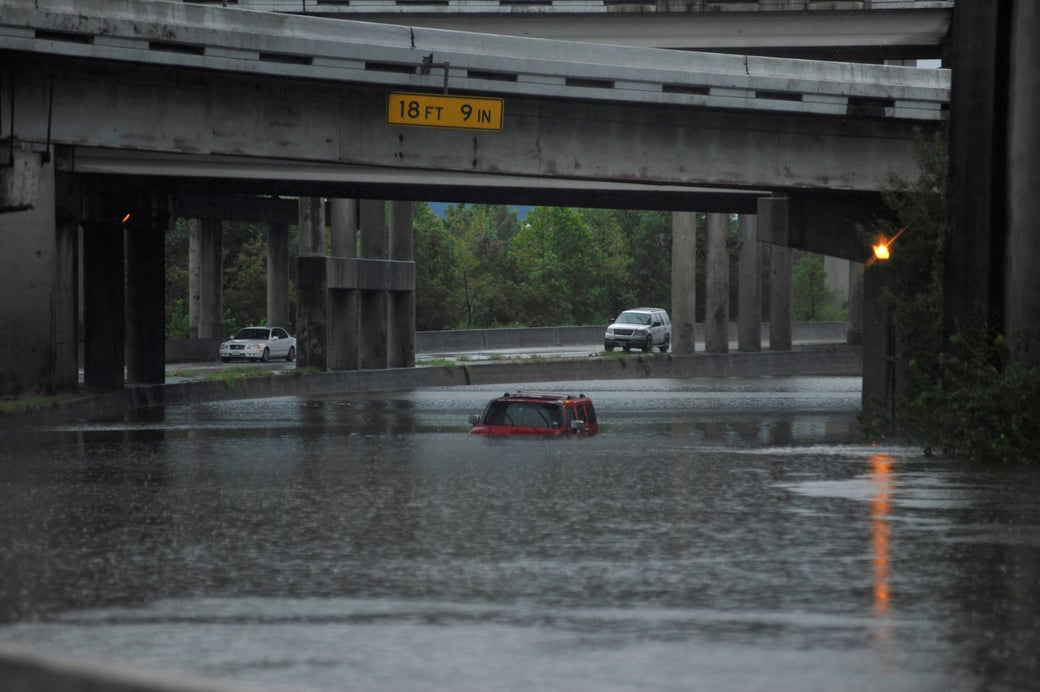 An abandoned Hummer is covered in floodwaters on Interstate 610 after Hurricane Harvey inundated the Texas Gulf coast with rain, in Houston, Aug. 27, 2017.