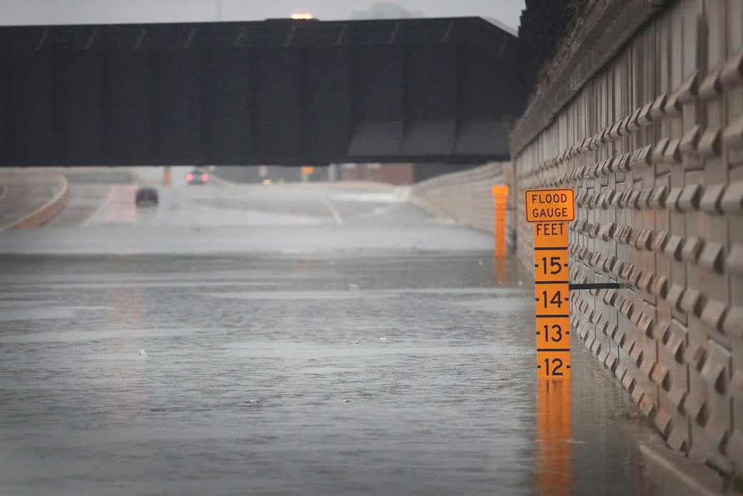A gauge shows the depth of water a an underpass on Interstate 10 in Houston, which has been inundated with flooding from Hurricane Harvey on Aug. 27, 2017.