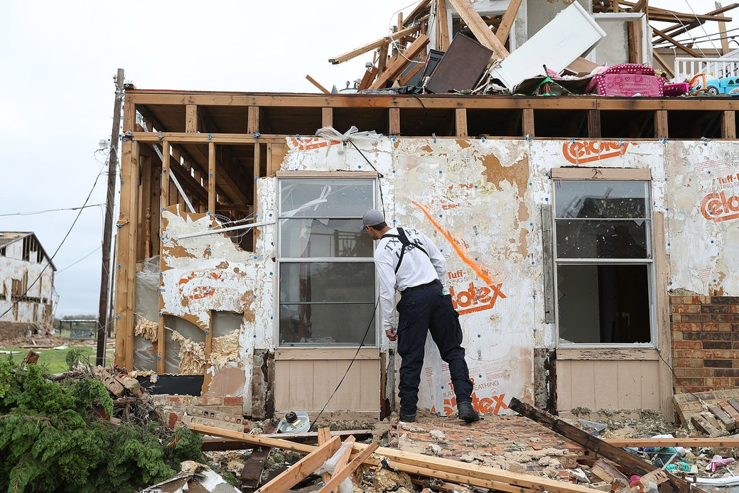 A member of the Texas Task Force 2 search and rescue team works through a destroyed apartment complex trying to find anyone that still may be in the apartment complex after Hurricane Harvey passed through on Aug. 27, 2017 in Rockport, Texas.