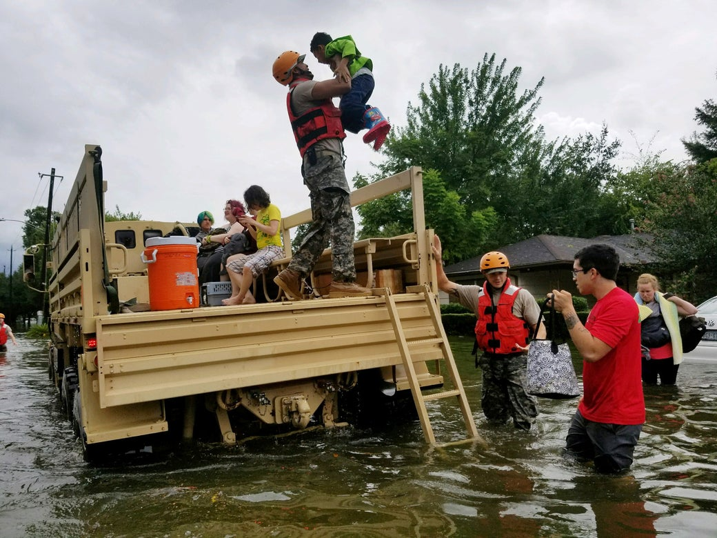Texas National Guard soldiers aid residents in heavily flooded areas from the storms of Hurricane Harvey in Houston, on Aug. 27, 2017.