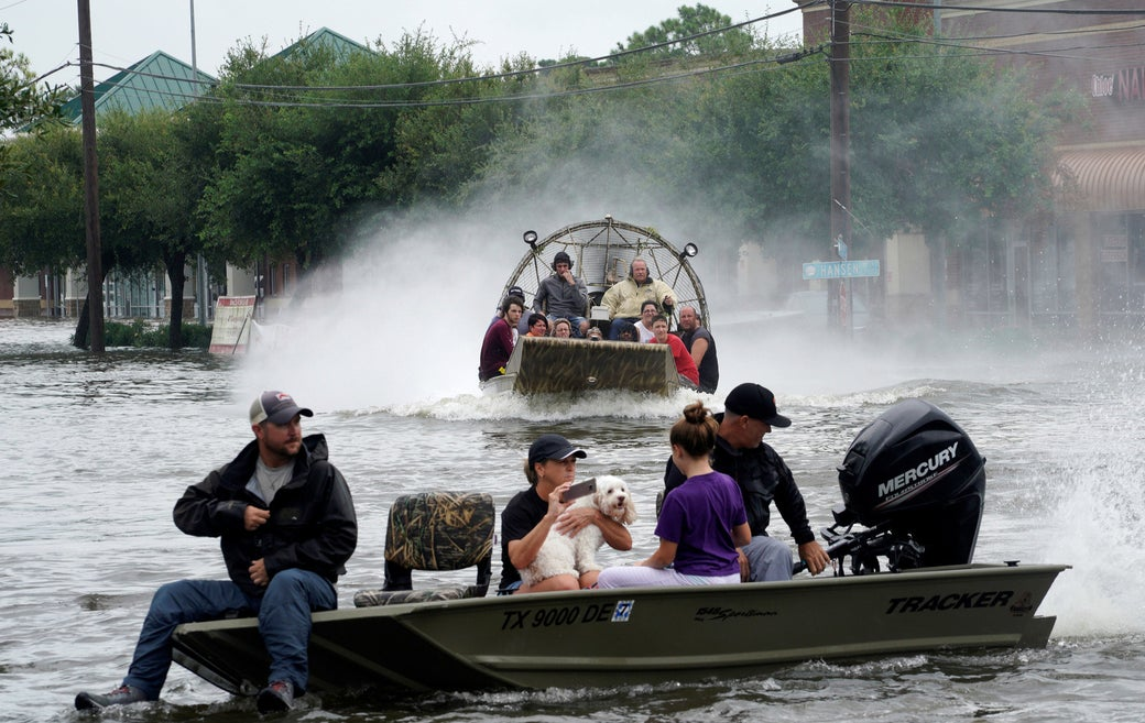 People are rescued from flood waters from Hurricane Harvey on an air boat in Dickinson, Texas, Aug. 27, 2017.