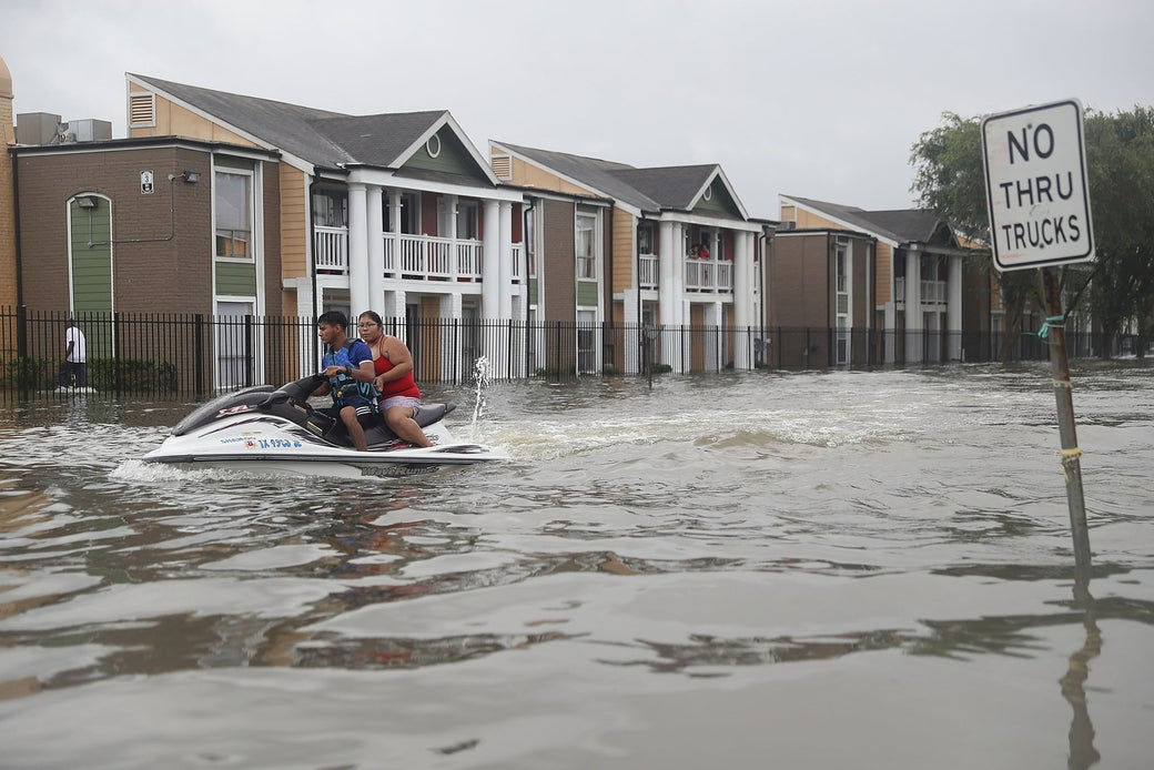 A Jetski is used to help people evacuate homes after the area was inundated with flooding from Hurricane Harvey on August 27, 2017 in Houston, Texas.