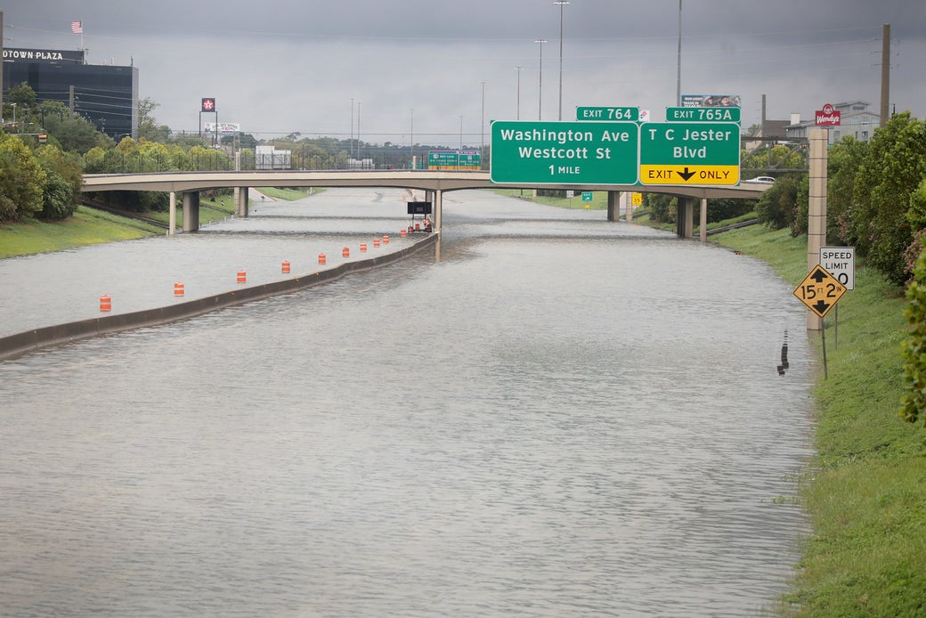 Water flows down Interstate 10 which has been inundated with flooding from Hurricane Harvey on August 27, 2017 in Houston, Texas.