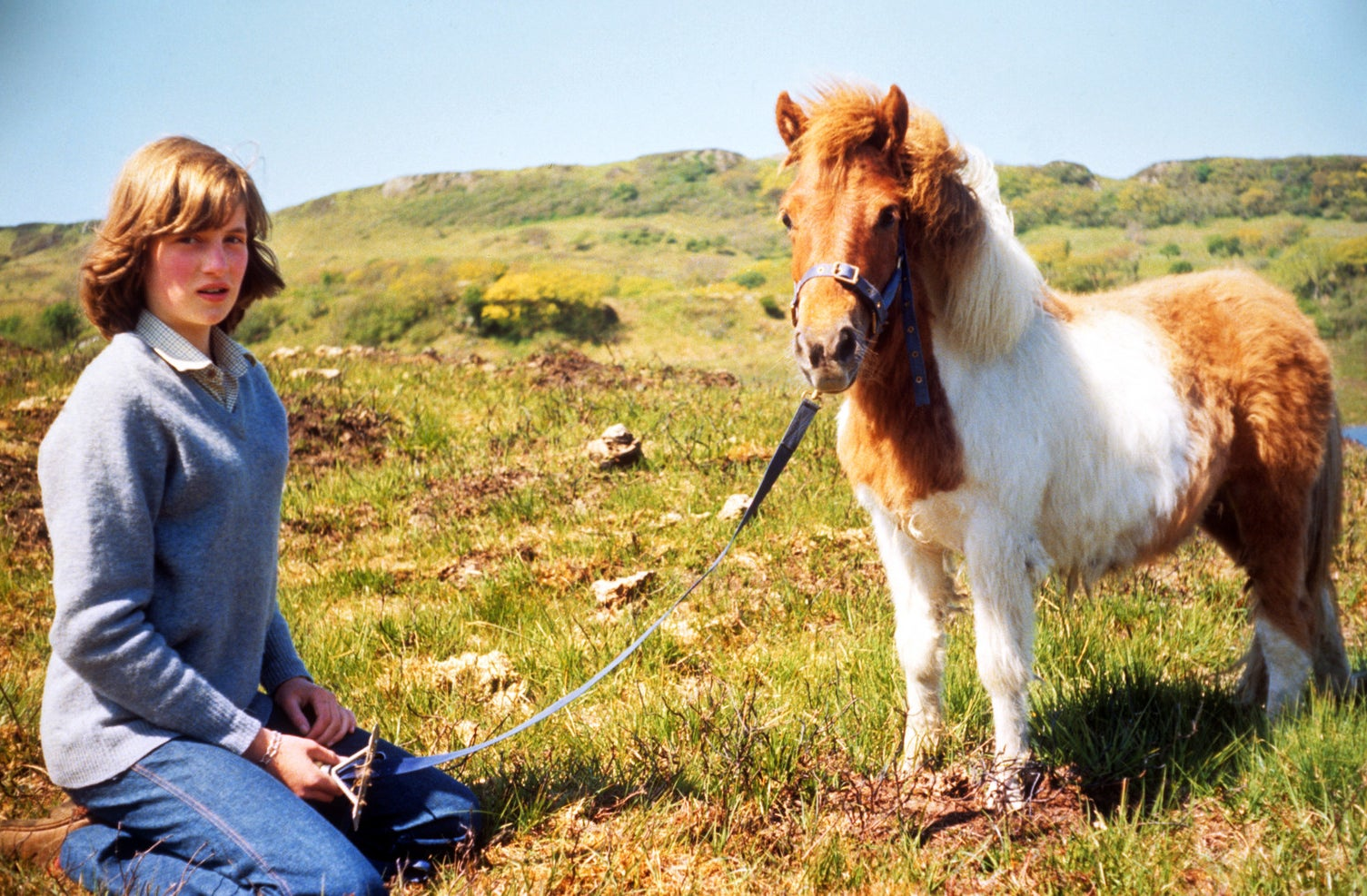 Lady Diana Spencer with a Shetland pony at her mother's home in Scotland, 1974.