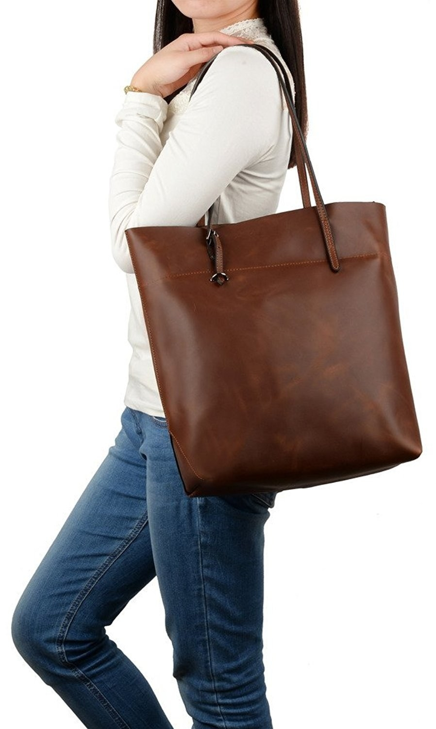 A roomy tote with a distressed finish that ll fit your laptop and notebooks  while keeping its shape. 76b59cc187cb1