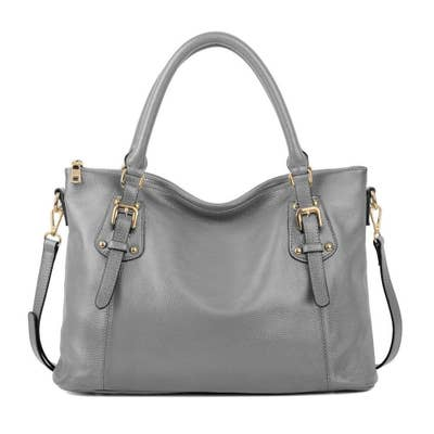 8476a98095 A spacious carryall to be the perfect work and travel bag. The large size  can fit a 15