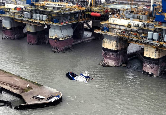 In this handout provided by the U.S. Coast Guard, the Signet Enterprise is sinking as helicopter aircrews were launched to assist the people in distress aboard the vessels near Port Aransas, Texas in response to Hurricane Harvey, August. 26, 2017.