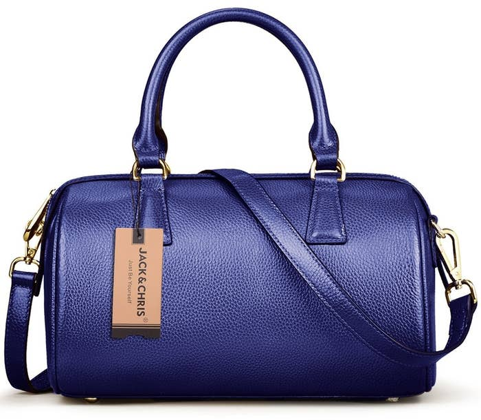 56dbb839354b A small duffle bag that s the definition of understated luxury. It s big  enough to hold an iPhone Plus