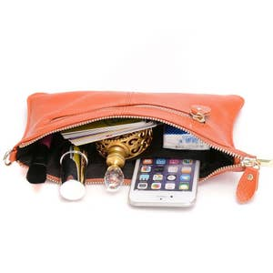 537da47c1e1b 30. A wristlet that comes with a crossbody chain so you can be hands-free  and happy.