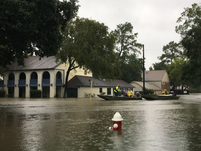 A flooded intersection in the Ponderosa Forest neighborhood near Houston Monday.