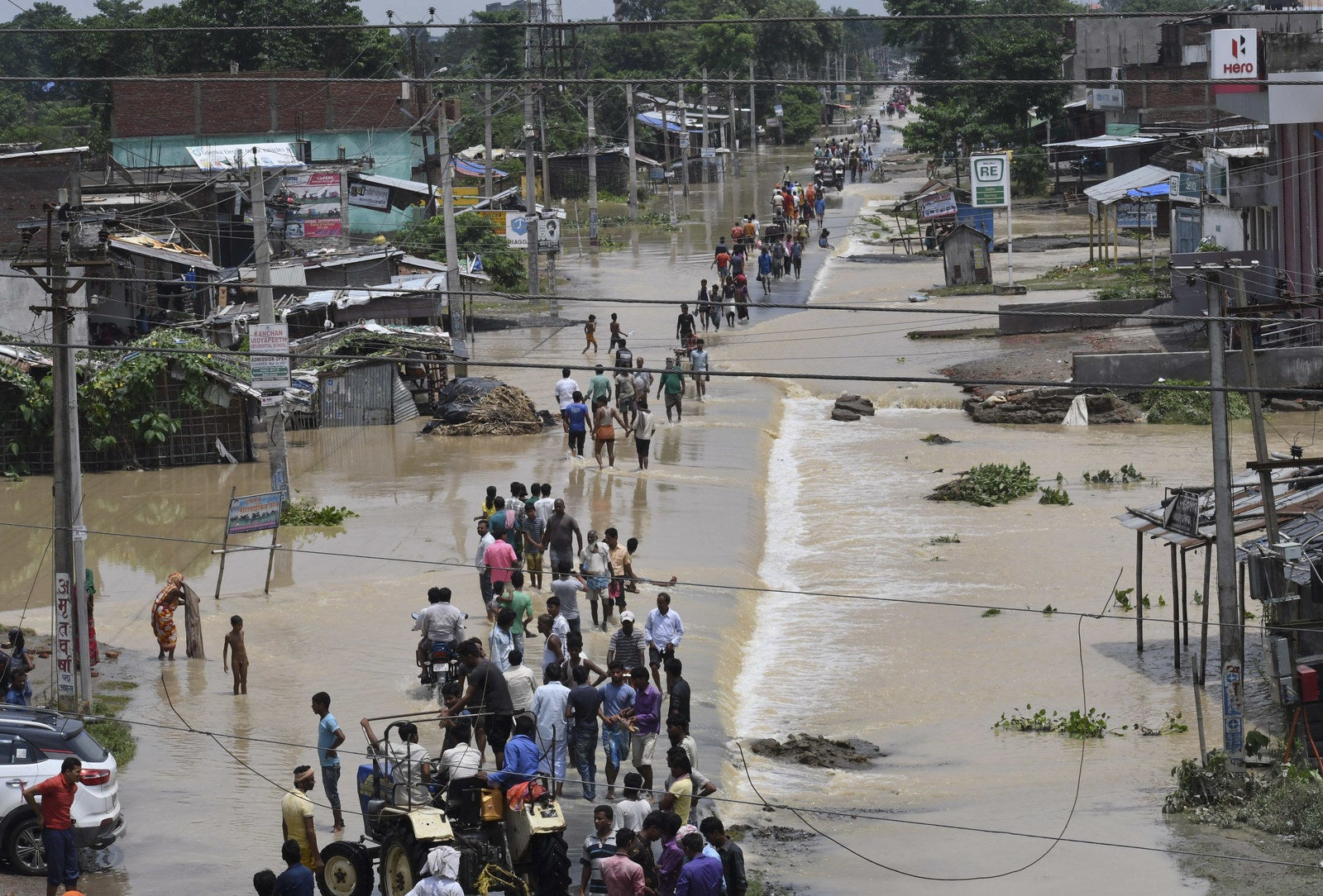 Flood-affected villagers move out in search of safer places in Bihar, India.