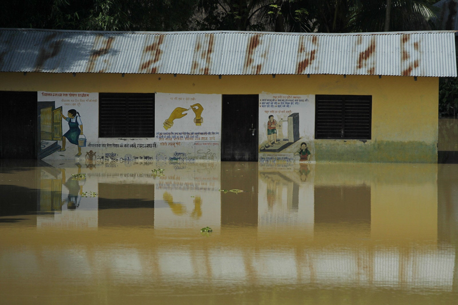A Nepali school is surrounded by flood waters in Saptari district.