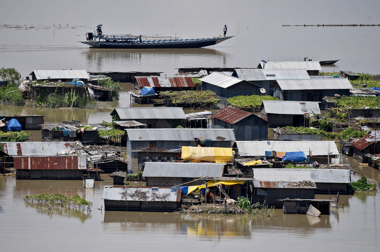 Houses are partially submerged by floods in Morigaon district in Assam.