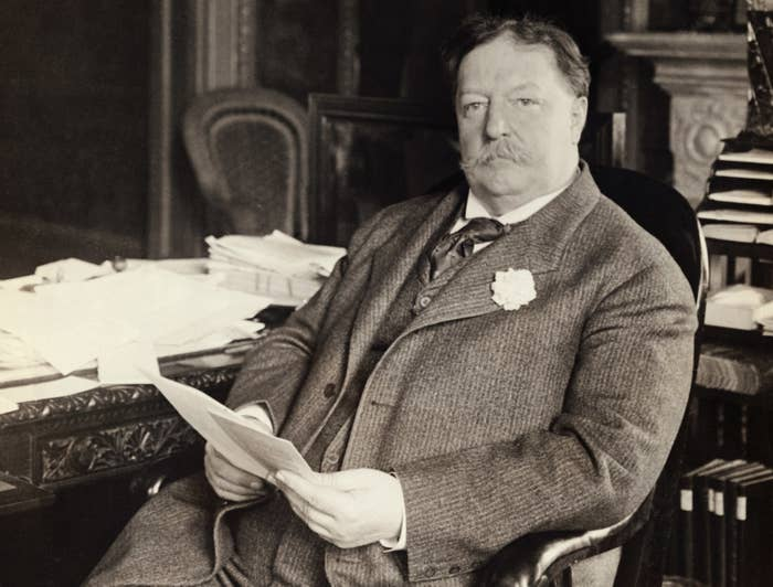 William Howard Taft shown seated here in his office.