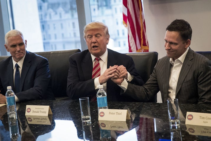 President Donald Trump shakes the hand of billionaire venture capitalist and transition team member Peter Thiel during a meeting with technology executives at Trump Tower in December.
