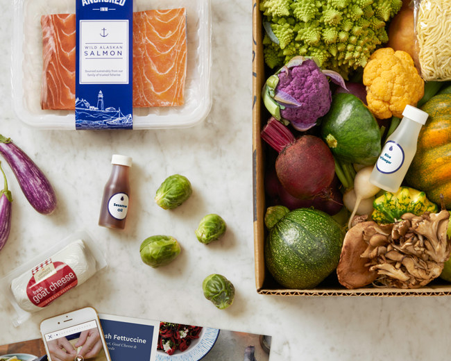salmon, goat cheese, Brussel sprouts, and other ingredients with a recipe card