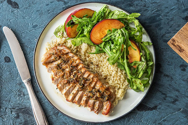 grilled chicken and couscous with a peach and arugula salad