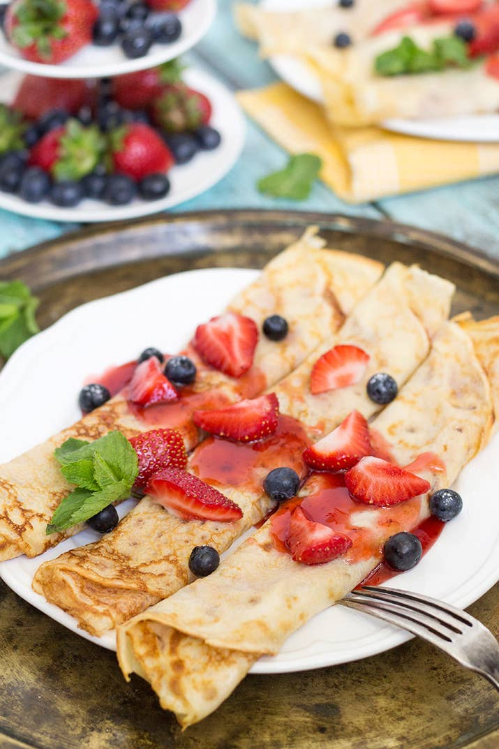A sort of pancake-crepe hybrid, Swedish pancakes, this light and airy breakfast is often topped with powdered sugar, jam, and berries. Get the recipe.