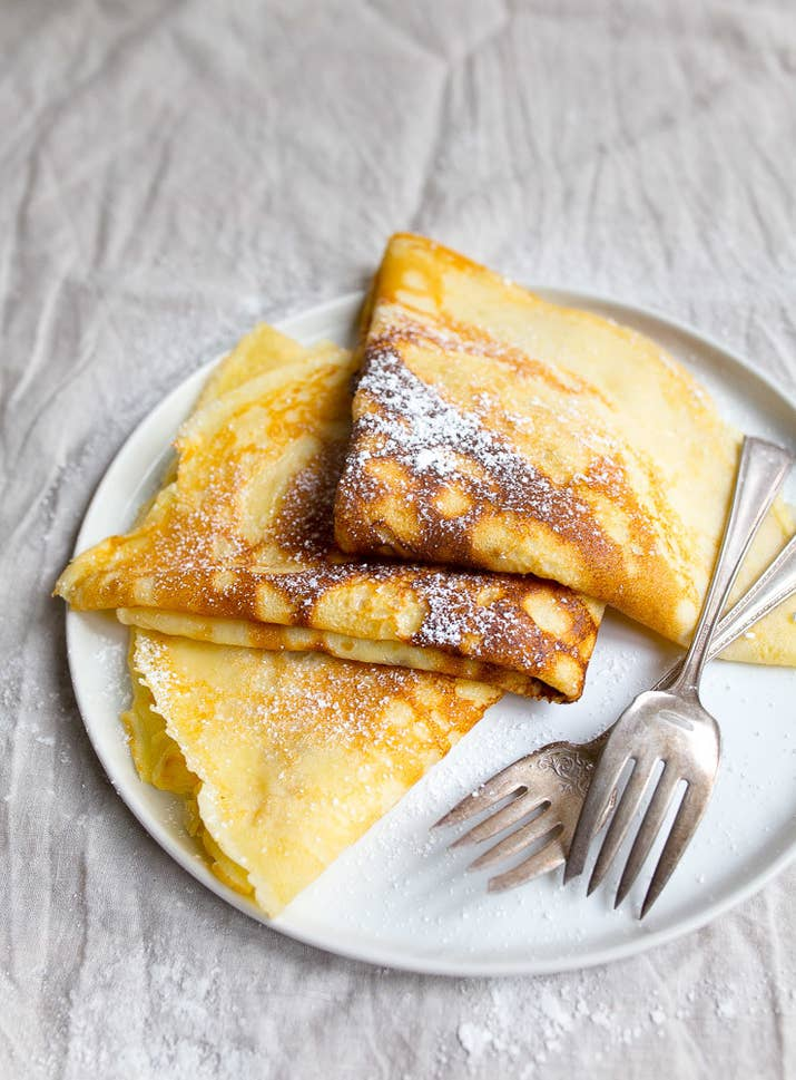 These super thin pancakes vary depending on where in France you order them, but they're made with either wheat or buckwheat. They can be served with savory or sweet toppings from ham and Gruyère to strawberries and Nutella. Most simply, they're served plain with a drizzle of powdered sugar.