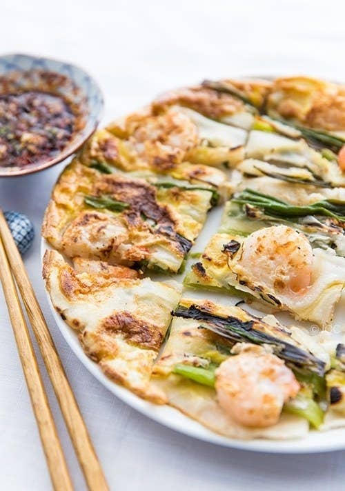 Pajeon is the Korean version of scallion pancakes. This savory dish is often filled with seafood like squid and shrimp and called Haemul Pajeon. Get the recipe.