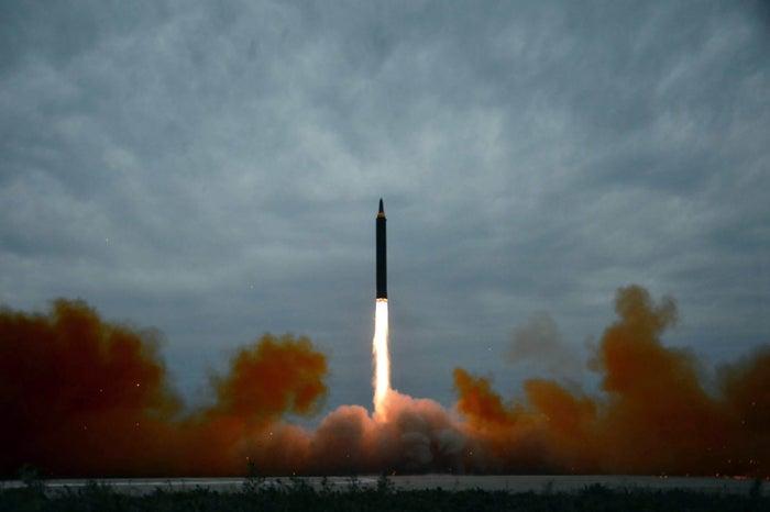 North Korea's intermediate-range strategic ballistic rocket Hwasong-12 lifting off from the launching pad at an undisclosed location near Pyongyang