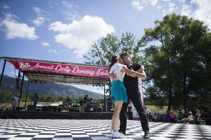 Asheville Ballet Assistant Artistic Director Lyle Laney dances with fellow ballerina Fleming Lomax during a performance at the Dirty Dancing festival in Lake Lure.