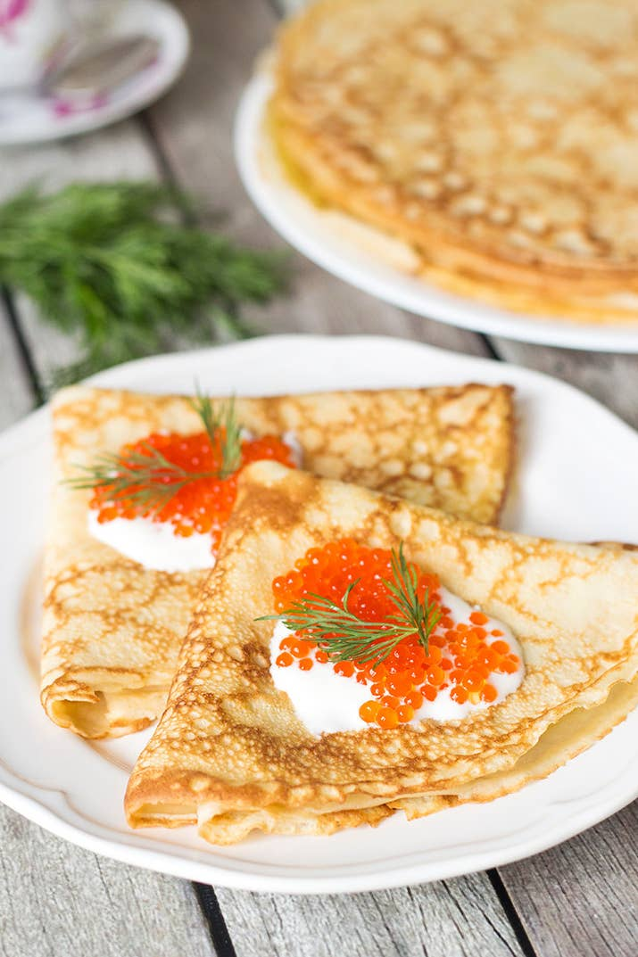 The Russian version of crepes, called Blini, are served for breakfast, lunch, or dinner. You may see them topped with butter and fruit or salmon and caviar. Get the recipe.