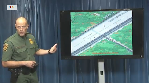 Ronald Vitiello, acting deputy commissioner of US Customs and Border Protection (CBP) showing reporters renderings of where the wall would be built.