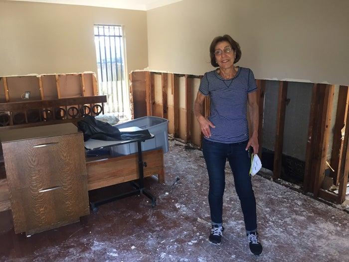 Dora Yudelevich stands in her flood-damaged bedroom Thursday.