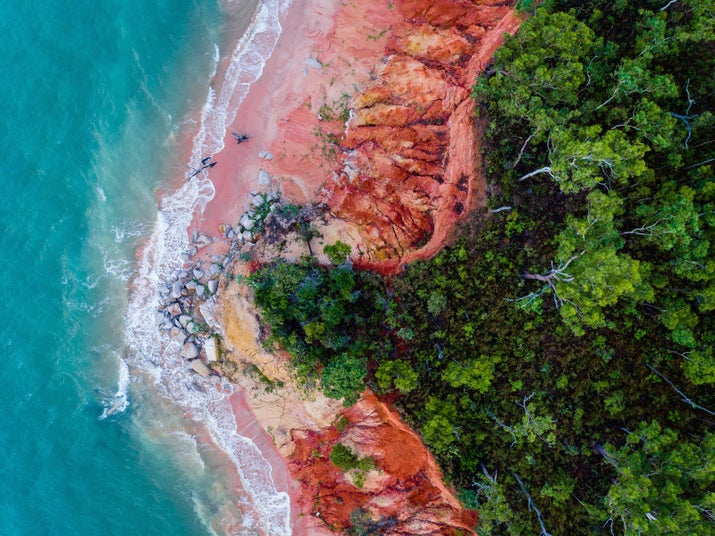 Melville Island is 80km off the coast of Darwin, and a boat ride early in the morning is well worth the effort. Some people have started calling its shores Rainbow Beach, because at sunrise — when the light is softer — you're treated to a palette of colours that might remind you of a Rainbow Paddle Pop!