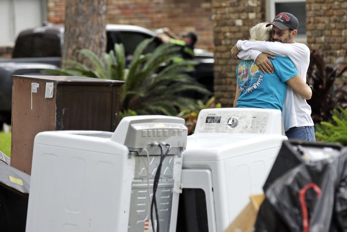 Barry Horvitz embraces his wife Kim while standing outside their home in Houston.