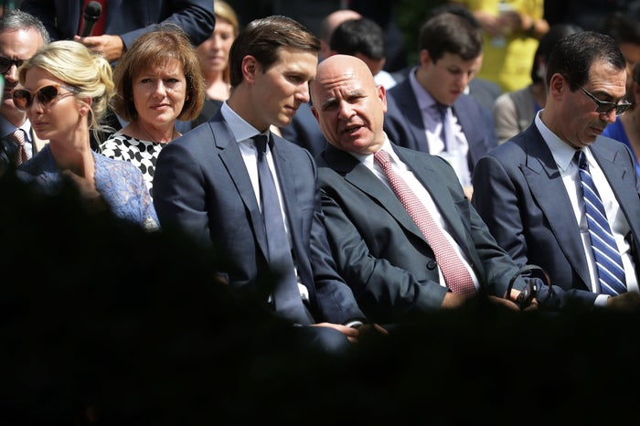 H.R. McMaster shares a moment with Trump son-in-law Jared Kushner.