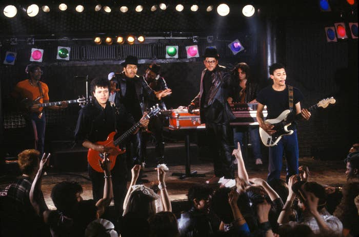 Run-D.M.C. perform with members of their backup band in New York City on May 1, 1984.