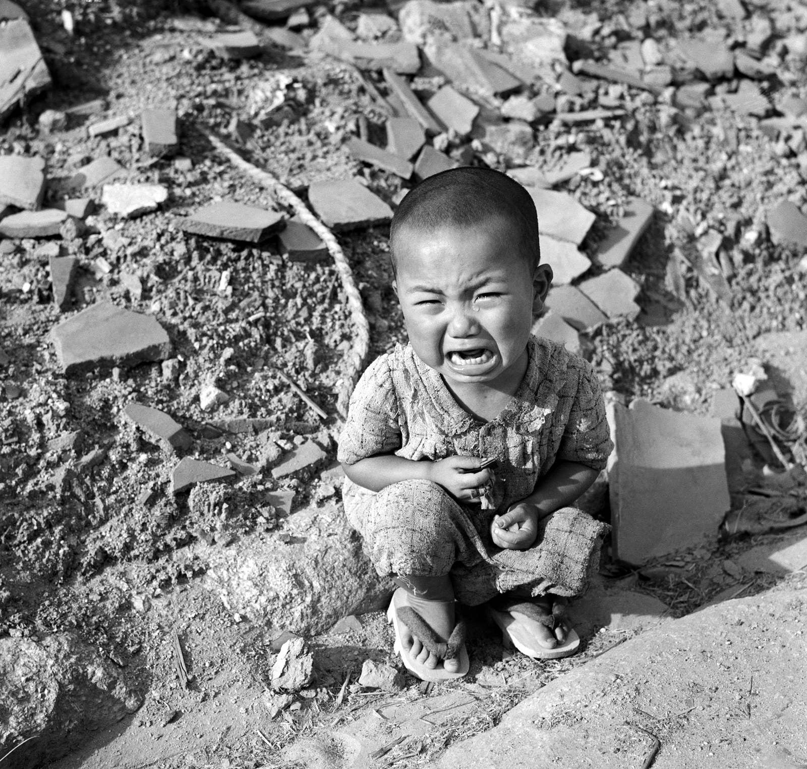 disturbing pictures from the aftermath of nuclear warfare a ese baby sits cries in the rubble following the explosion in hiroshima on aug
