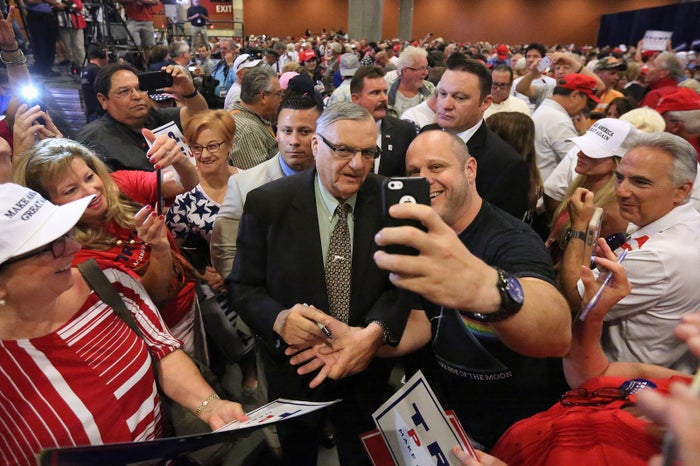 Former Arizona Sheriff Joe Arpaio poses for photos with people before Republican presidential nominee Donald Trump speaks at a campaign rally in Phoenix in 2016.
