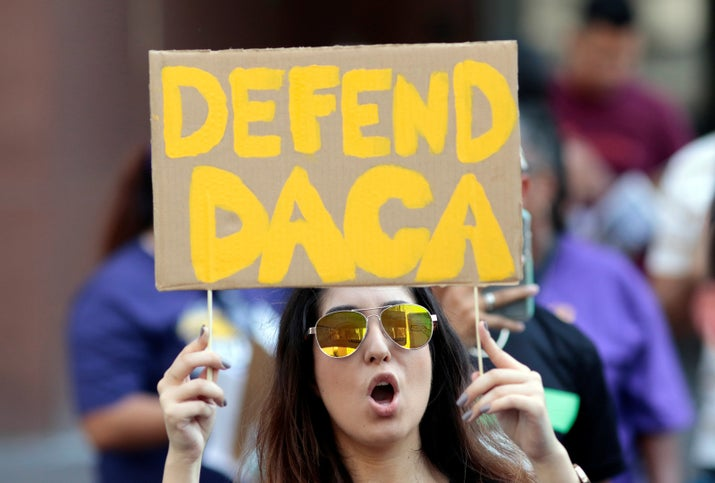 Yessenia Lopez stands with supporters of the Deferred Action for Childhood Arrivals program recipient during a rally outside the Federal Building in Los Angeles, California.