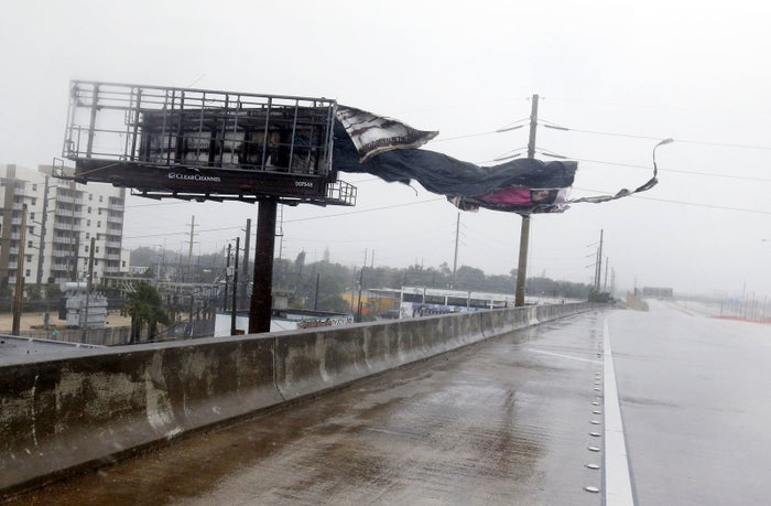 A billboard is ripped apart by high winds along Interstate 95 Northbound in Miami.