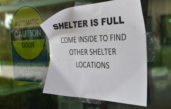 A sign is posted on a door at a hurricane shelter in Naples, Florida.
