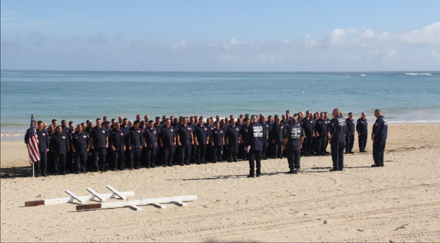 Over 1,500 miles away from home, New York City police officers and firefighters conducting hurricane rescue operations in Puerto Rico paid their respects to those who lost their lives on September 11th, 2001 on Monday morning.