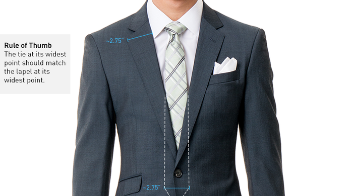 """So here's a general suit rule: """"Your tie at its widest should be the same width as your lapel,"""" according to Black Lapel. That's because suits all about proportions, and essentially you want everything to look as even and clean as possible."""