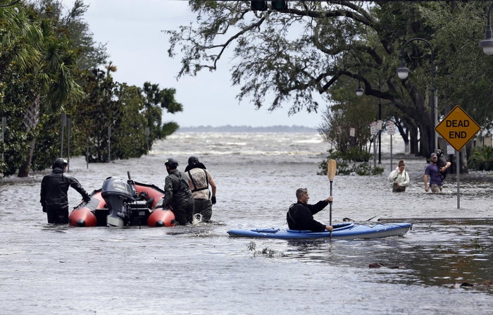 Rescue workers search a Jacksonville neighborhood for flood victims on Sept. 11.