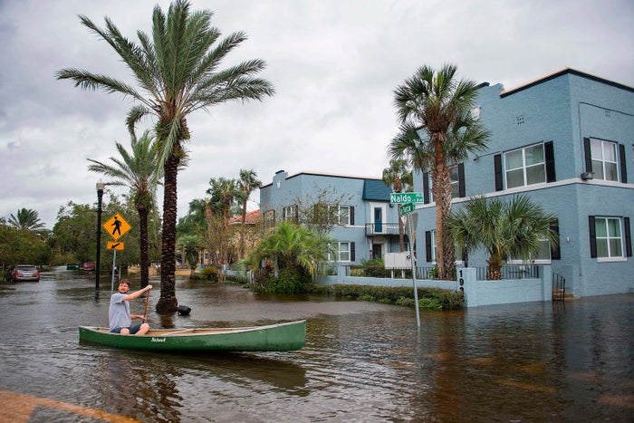A man canoes through the flooded streets of the San Marco historic district of Jacksonville on Sept. 11.