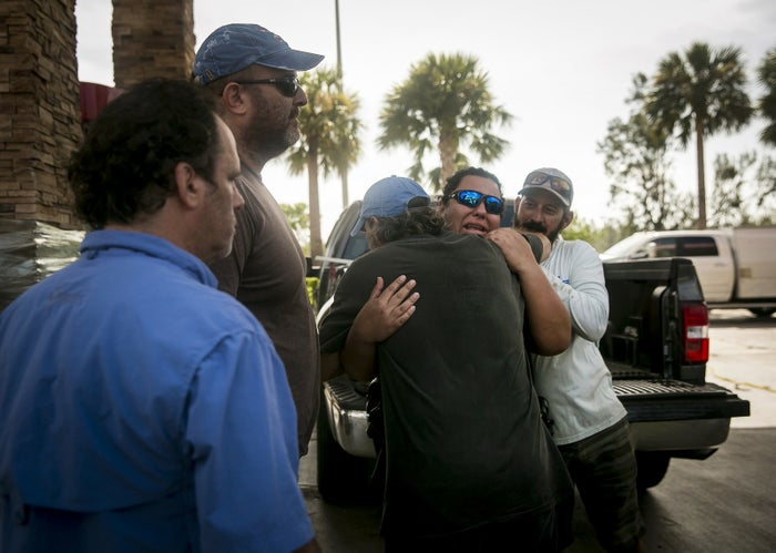Residents plead with local law enforcement at a Race Trac off of Highway 1 leading into the Keys on Monday morning.