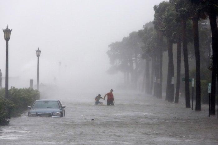 Pedestrians wade through a flooded street as Irma makes landfall in Charleston on Sept. 11.