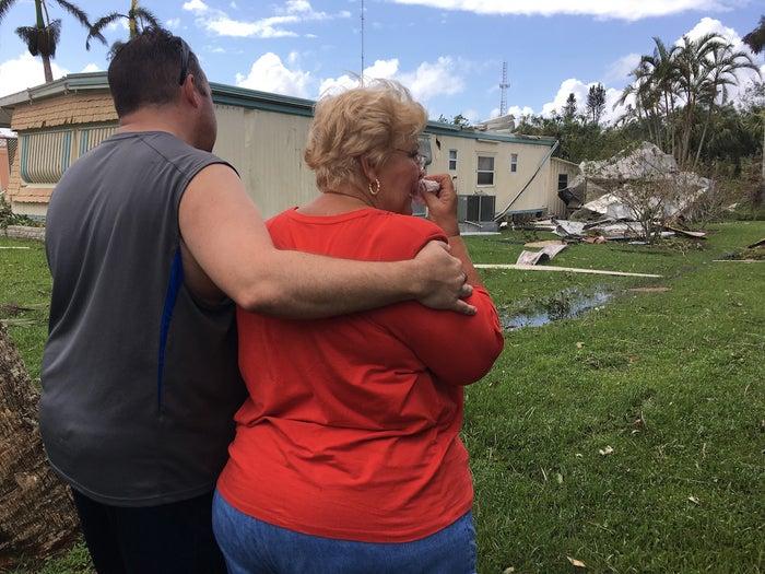 Emma Addison surveys her damaged home in Naples, Florida, Monday.